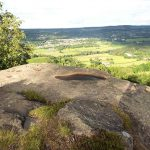 A rocky outcrop on Stanton Moor - Looking across the valley